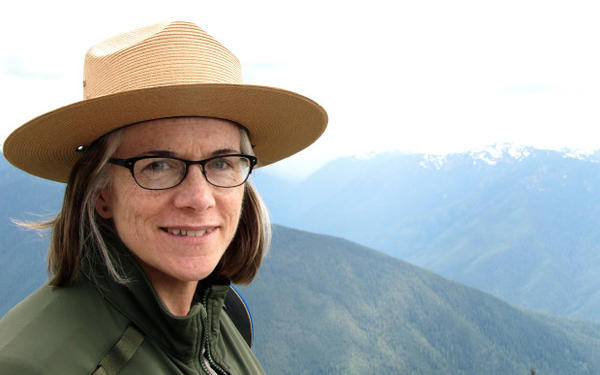 "<p>Barb Maynes has handled communication for Olympic National Park for 26 years. ""Those mountain tops typically would be absolutely covered in snow,"" she said on a recent visit to Hurricane Ridge.</p>"