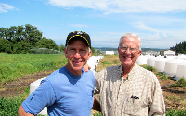 <p>Ben Smith (left) and his father, Gary Smith at Maple View Farm in Sequim, Washington, which has been in their family for four generations.</p>