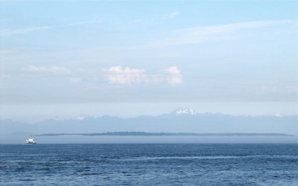 <p>A view of the Olympic Mountains from downtown Seattle. Snowpack was at 0% of normal levels in May. </p>
