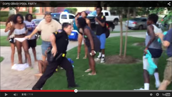 An officer from the McKinney, Police Department draws his weapon on teens at the pool.