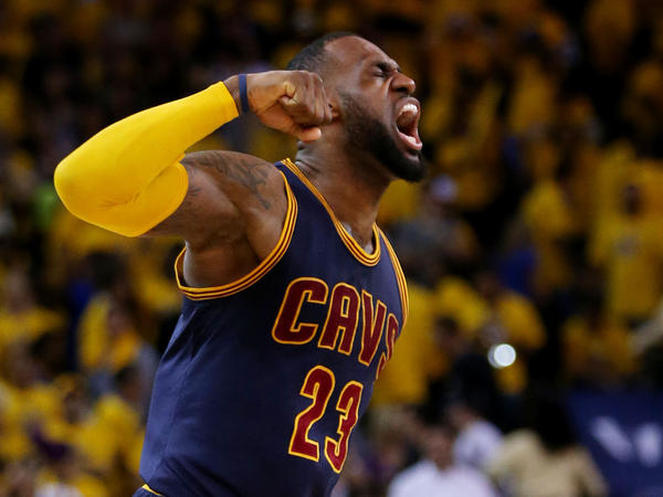 LeBron James celebrates the Cleveland Cavaliers' 95-93 win over the Golden State Warriors in overtime during Game 2 of the 2015 NBA Finals in Oakland, Calif.