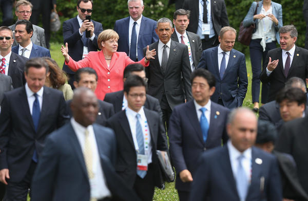German Chancellor Angela Merkel, President Obama and other G-7 leaders arrive for the second day of the summit on Monday.