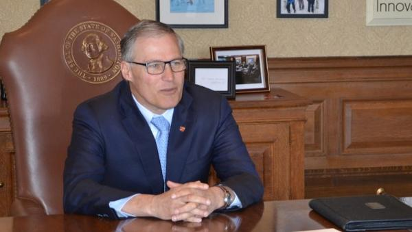 A file photo of Washington Gov. Jay Inslee at his Capitol office. The governor is proposing a carbon-trading program and other steps to reduce greenhouse gas emissions.