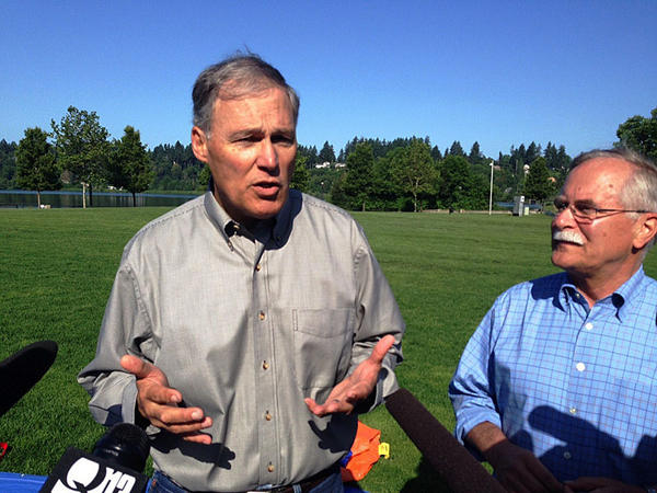 Washington Governor Jay Inslee and state Land Commissioner Peter Goldmark discuss wildfire dangers after practicing getting into a fire shelter.
