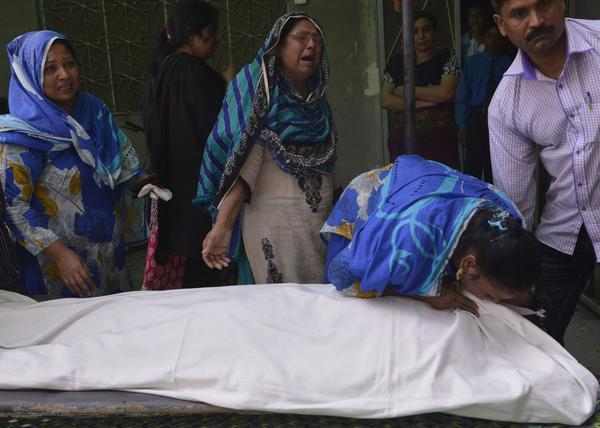 Relatives of convicted murderer Aftab Bahadur mourn beside his body after his execution in Lahore, Pakistan, on Wednesday. Bahadur was just 15 when he was accused of a 1992 murder. Pakistan has executed more than 150 people since lifting a moratorium on the death penalty last December.