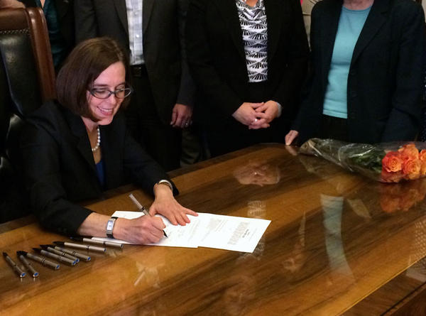 Oregon Governor Kate Brown signs HB 3343 into law.