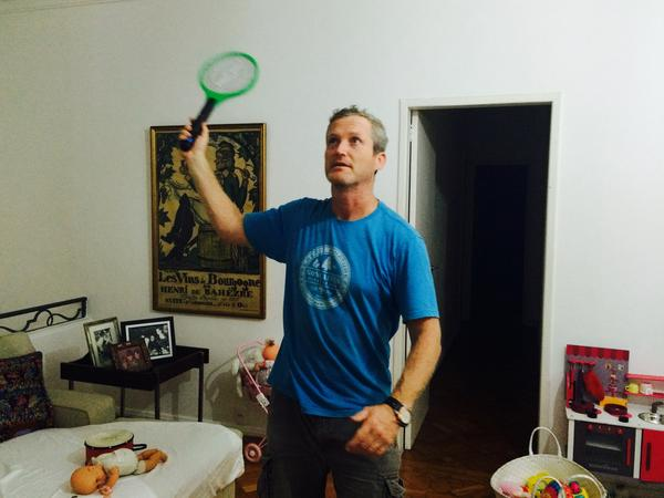 James Hider, the reporter's husband, wields the zapping racket to kill some pesky mosquitoes at their home in Rio de Janeiro, Brazil.