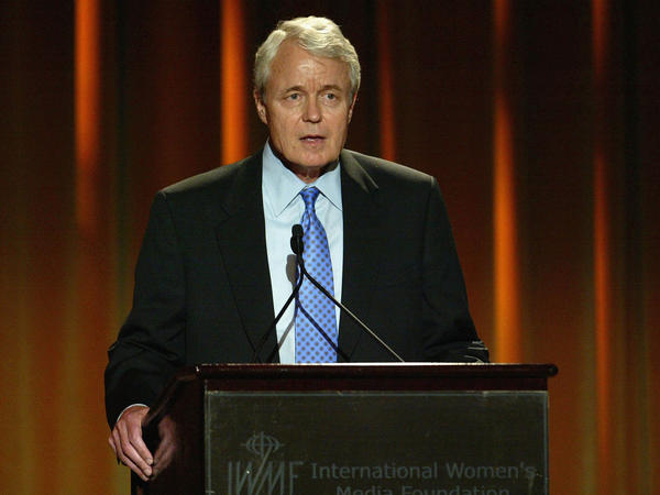 John Carroll speaks at the International Women's Media Foundation's 15th Annual Courage in Journalism Awards in 2004 in Beverly Hills, Calif. The former editor of the Los Angeles Times died Sunday at age 73.