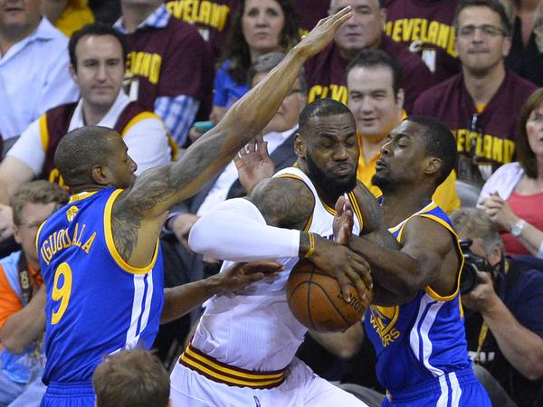 Cleveland Cavaliers forward LeBron James fights against the defense of Golden State Warriors forwards Harrison Barnes, right, and Andre Iguodala on Tuesday in the first half of Game 6 of the NBA Finals in Cleveland.