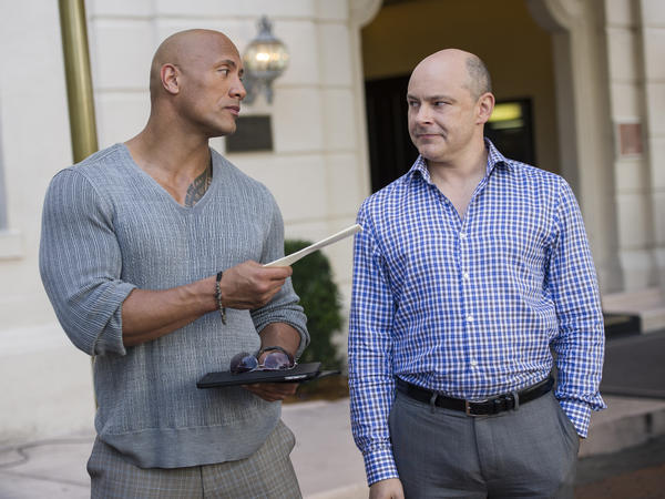 In <em>Ballers, </em>Dwayne Johnson (left) plays an ex-Dolphin who is trying to make the transition from pro football player to financial planner for wealthy athletes. His boss is played by Rob Corddry, from <em>The Daily Show.</em>
