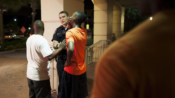 A man reacts while talking to police officer Wednesday night near the scene of shooting at the Emanuel AME Church in Charleston, S.C.