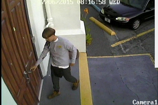 """Police described the suspect as a white man in his 20s. He was seen entering the church before the shooting. The man, whom police consider to be """"armed and dangerous,"""" left the church in a black sedan."""
