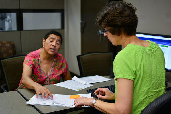 Anita Hoffman works with Elizabeth Colvin, director of Foundation Communities' Insure Central Texas, to sign up for a health insurance plan on June 17, 2015.