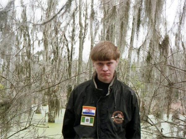 An undated handout photo provided by the Berkeley County, S.C., government shows Dylann Roof at an unknown location.