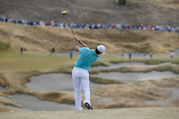 Rory McIlroy, of Northern Ireland, watches his tee shot on the fourth hole during the first round of the U.S. Open at Chambers Bay.