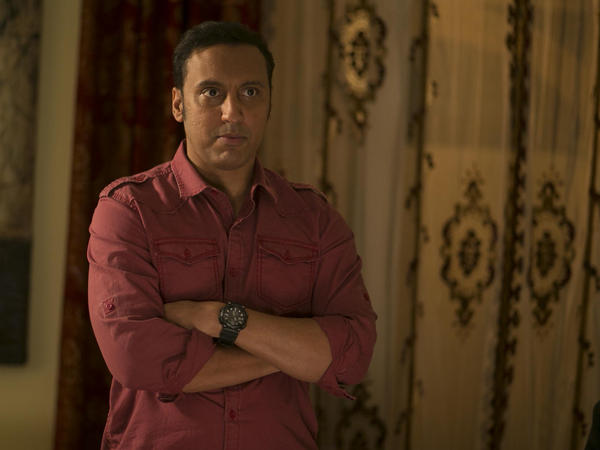 Aasif Mandvi plays a Pakistani driver and son of an educated, middle-class family in HBO's <em>The Brink</em>.