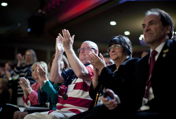 Members of the audience applause at the Road to Majority conference on June 19, 2015.