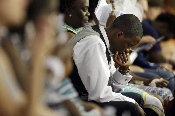 Church elders decided to hold the regularly scheduled Sunday school and worship service as they continue to grieve the shooting death of nine of the church's members, including its pastor, earlier this week.
