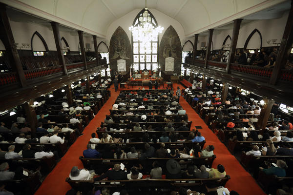 Parishioners gather at the Emanuel A.M.E. Church, four days after a mass shooting that claimed the lives of its pastor and eight others at the historic Emanuel African Methodist Church in Charleston, S.C., on Sunday.