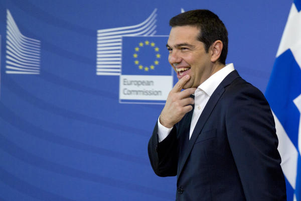 Greek Prime Minister Alexis Tsipras arrives for a meeting with European Commission President Jean-Claude Juncker before an EU summit in Brussels on Monday. He's hoping a new Greek proposal will end the deadlock on a bailout for Greece's economy.