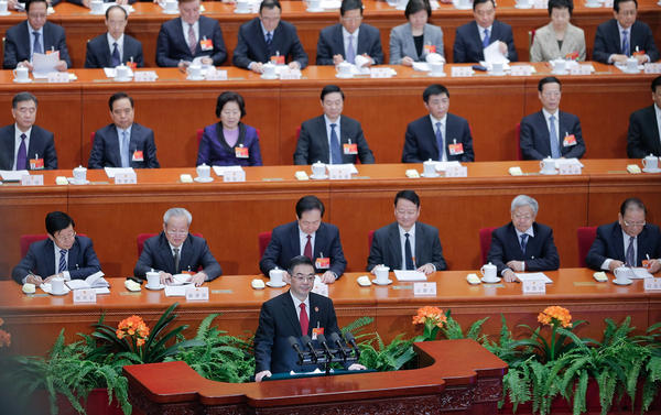 Zhou Qiang, president of the Supreme People's Court of China, speaks to the National People's Congress in Beijing on March 12. Chinese authorities are waging a major campaign against corruption, and that includes a list of 100 suspects believed to be overseas. Many are former officials who are thought to have fled to the U.S. or Canada.