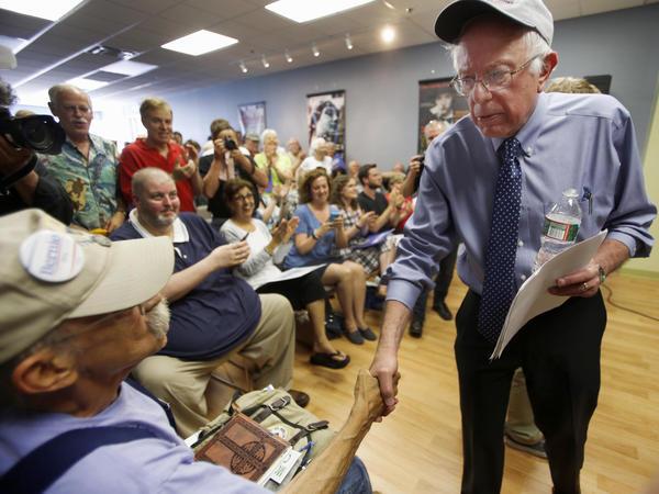 Democratic presidential candidate Sen. Bernie Sanders, I-Vt., shakes hands with Karl Bergeron of Northwood, N.H., in May in Concord, N.H.