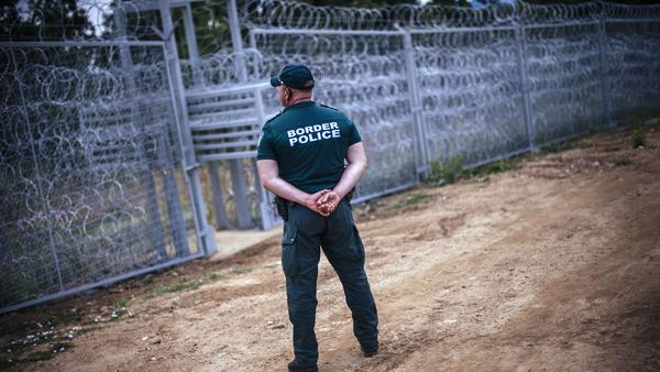 A Bulgarian border policeman stands near a barbed wire wall on the border with Turkey in July 2014. Experts believe that about two-thirds of the heroin that enters Europe comes through Bulgaria, and that a third of that moves on to the United States.