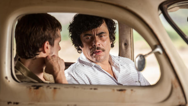 Josh Hutcherson and Benecio Del Toro in <em>Escobar: Paradise Lost</em>.