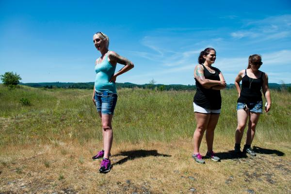 Washington Warrior Widows Founder Stephanie Groepper, left, stopped for a break alongside friend Amber Martini and new member Danielle Williams during a hike to Mima Mounds Natural Preserve.