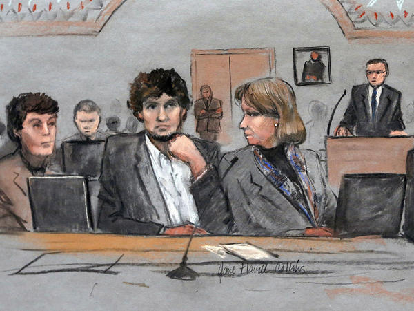 In this courtroom sketch, Dzhokhar Tsarnaev (center) is depicted between defense attorneys Miriam Conrad (left) and Judy Clarke during his federal death penalty trial on March 5.