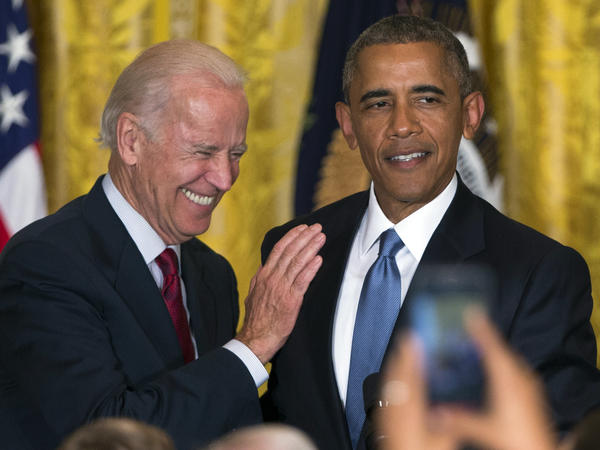 Vice President Joe Biden and President Obama share a laugh after a heckler was removed from the East Room of the White House during a reception to celebrate LGBT Pride Month on Wednesday.
