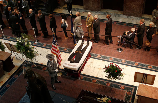 Mourners view the body of state Sen. Clementa Pinckney as he lay in state at the South Carolina State House Wednesday. Pinckney was one of nine people killed during a Bible study inside Emanuel AME church in Charleston.