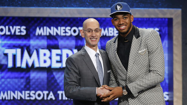 Power forward Karl-Anthony Towns shakes hands with NBA Commissioner Adam Silver shortly after being taken first in the NBA Draft by the Minnesota Timberwolves.