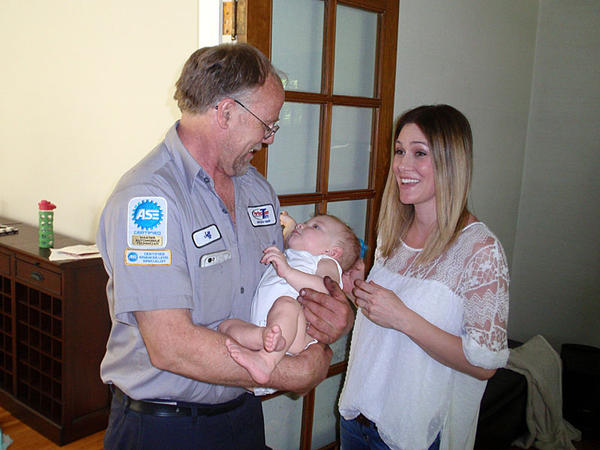 Mechanic and volunteer EMT Jeff Olson visits the baby whose life he saved last September. Mother Karen Garrison looks on in Spokane.