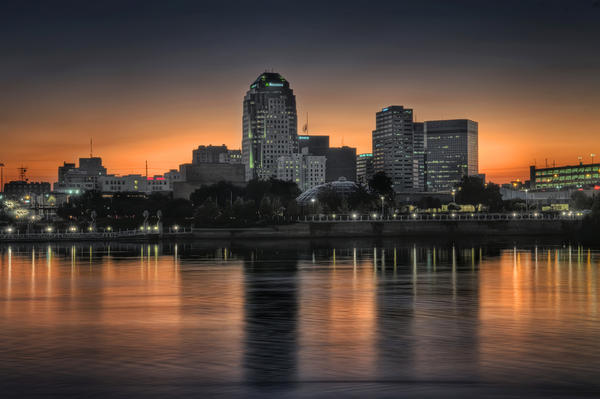 Downtown Shreveport at dusk, as seen from the Bossier City bank of the Red River.