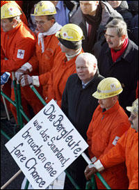 Left Party leader Oskar Lafontaine protests with miners against the closure of mines in Saarbrucken, Germany, on March 5.