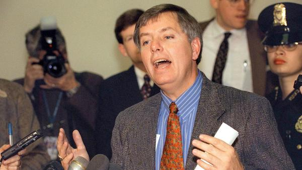 Graham speaks to reporters in December 1998 about the impeachment trial against President Bill Clinton.