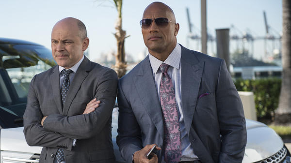 "Dwayne ""The Rock"" Johnson (right) stars opposite Rob Corddry in the HBO series <em>Ballers</em>."