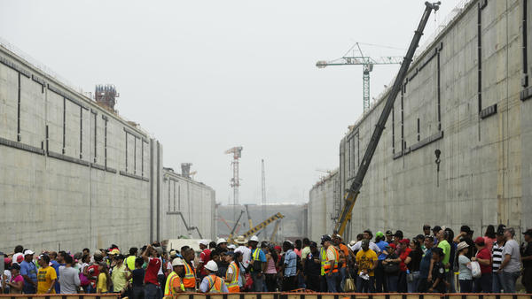 People walk inside the expanded Panama Canal's new set of locks in May before they are flooded, in Cocoli, near Panama City.
