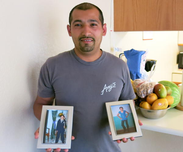 Carlos Leveron, 38, left El Salvador in 1999 and came to California to support his family. He holds pictures of his son Freddy David, 18, and his daughter Marta Elsie, 19. He has not seen either in 16 years, but a new U.S. program has raised the possibility that they will be able to move to the U.S.