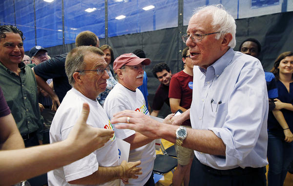 Sen. Bernie Sanders greets supporters after speaking during a town hall meeting at Nashua Community College in Nashua, N.H., Saturday, June 27. As Sanders rises in many early polls, his economic agenda is drawing the fire of some Clinton supporters.
