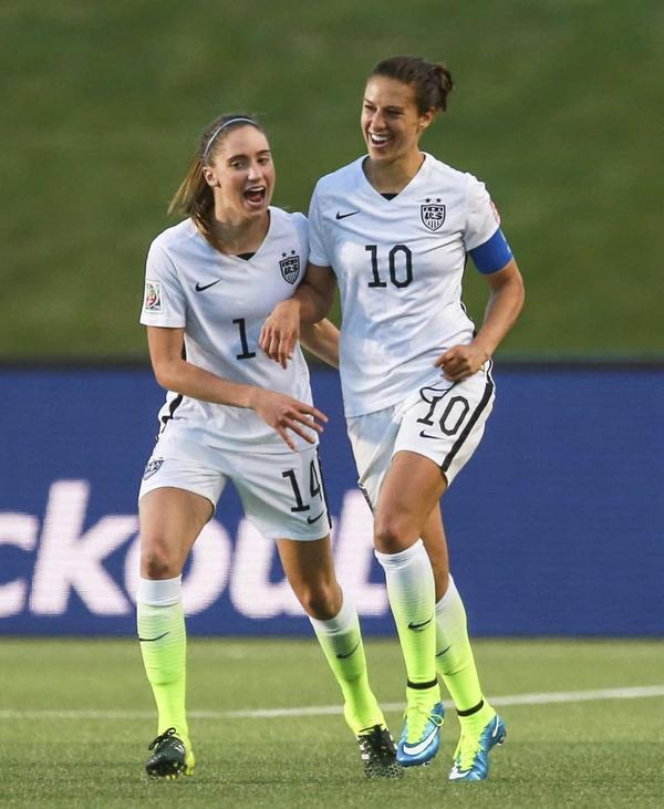 Carli Lloyd (right) celebrates with Morgan Brian during the U.S. match against China at the FIFA Women's World Cup 2015.
