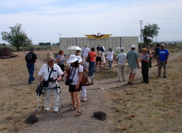 Minidoka ''pilgrims'' admire the re-created Honor Roll, which stood near the camp entrance and listed the names of internees who joined the U.S. armed forces during WWII.