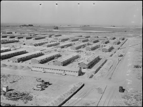 A panorama view of the Minidoka War Relocation Authority center in 1942. This view taken from the top of the water tower at the east end of the Center, shows partially completed barracks.
