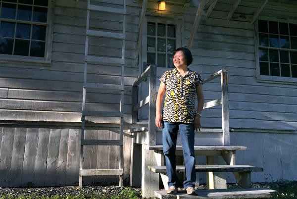 Former refugee Kuo Nam Lo, the reporter's mother, stands outside an old army barracks that's been converted into the Pennsylvania National Guard Military Museum at Fort Indiantown Gap.