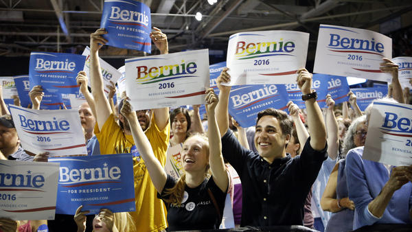 Supporters of Democratic presidential candidate Sen. Bernie Sanders, I-Vt., cheer at a campaign rally in Portland, Maine. Sanders is packing 'em in: 10,000 people in Madison, Wis.; more than 2,500 in Council Bluffs, Iowa; another 7,500 in Portland.