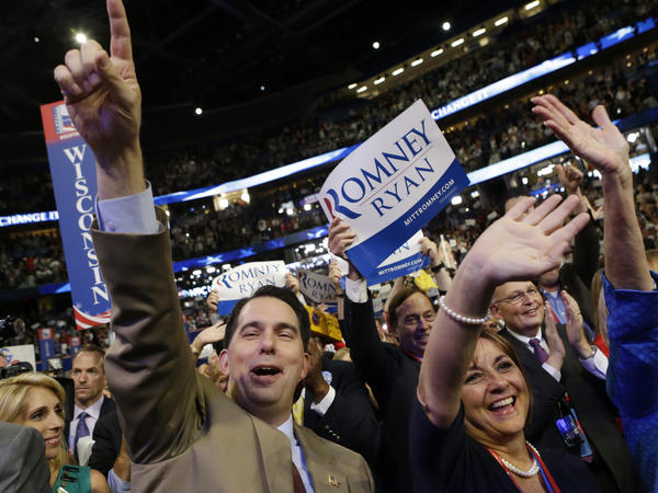 Wisconsin Gov. Scott Walker and his wife, Tonette, cheer during the 2012 Republican National Convention in Tampa, Fla. Tonette Walker's views on issues such as same-sex marriage are potentially at odds with those of her husband, who is expected to announce his presidential run Monday.
