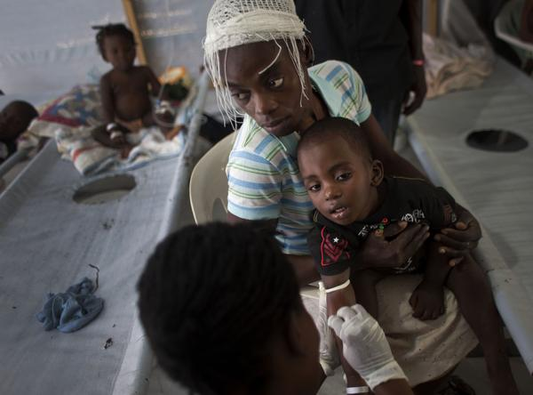 A family receives treatment for cholera at a clinic run by Doctors Without Borders in Port-au-Prince, Haiti, in October 2011, a year after the overwhelming outbreak began.