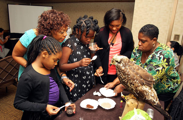 Mamie Parker (second from left) looks on as young participants at a workshop hosted by The Black Women's Agenda in Washington, D.C., last fall learn about the effects of pollution and human habits on sea life.