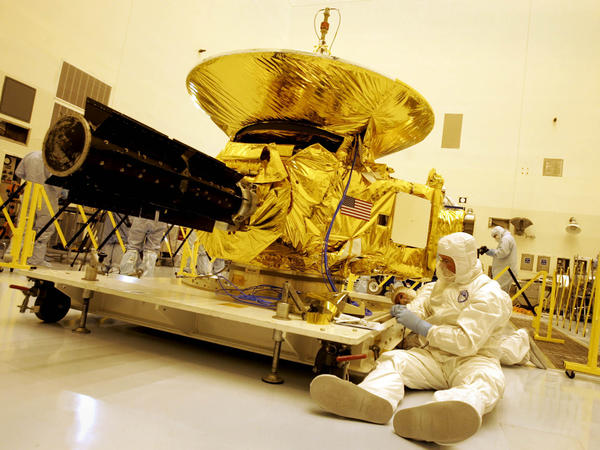 Technicians prepped the New Horizons spacecraft on Nov. 4, 2005, at the Kennedy Space Center in Cape Canaveral, Fla. Fired into space in 2006, the probe is scheduled to finally get close to Pluto on Tuesday.